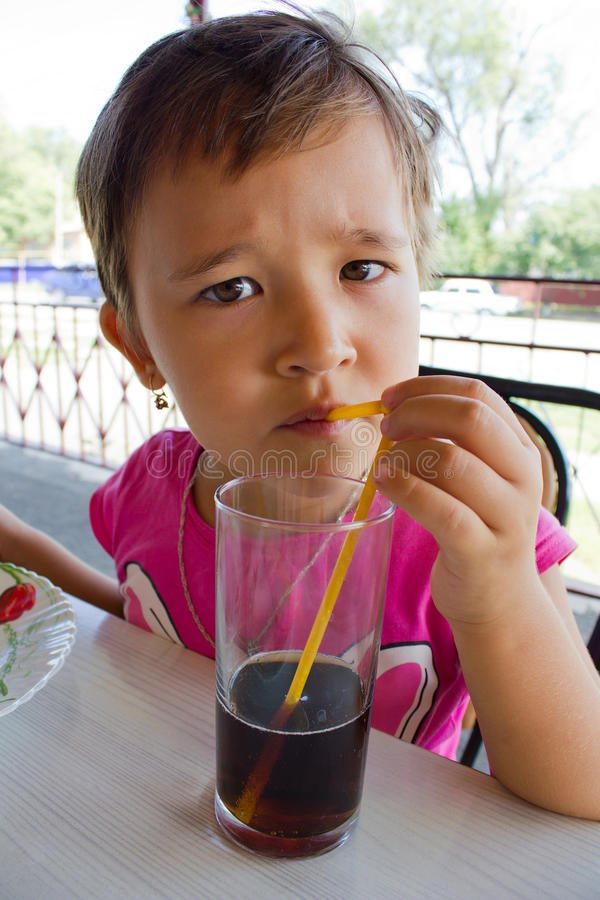 Download A Little Girl Drinking Juice Stock Photo - Image: 25961406
