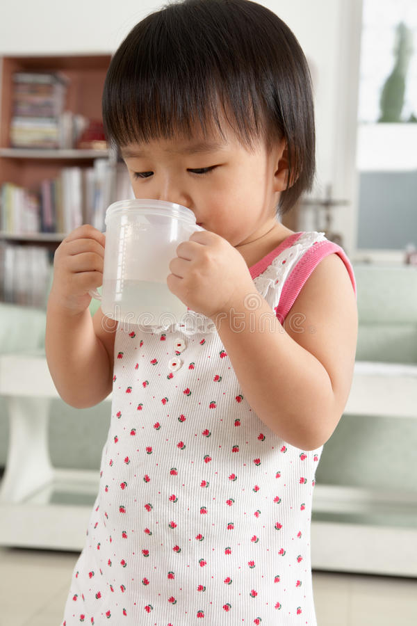 Download Little girl drinking water stock photo. Image of holding - 14715442