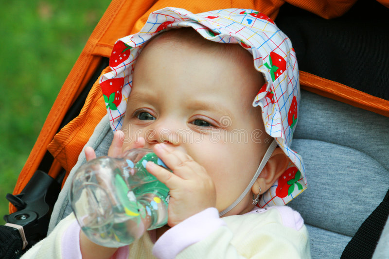 Little girl is drinking water royalty free stock photography