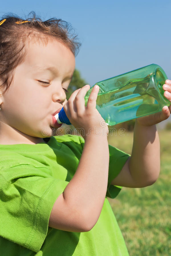 Download Little girl drinking water stock image. Image of girl - 25227877