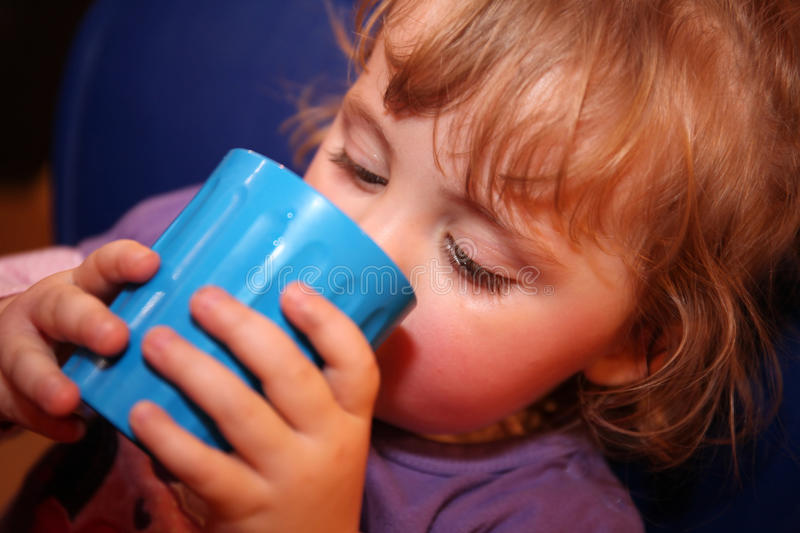 Little girl drinking water royalty free stock photo