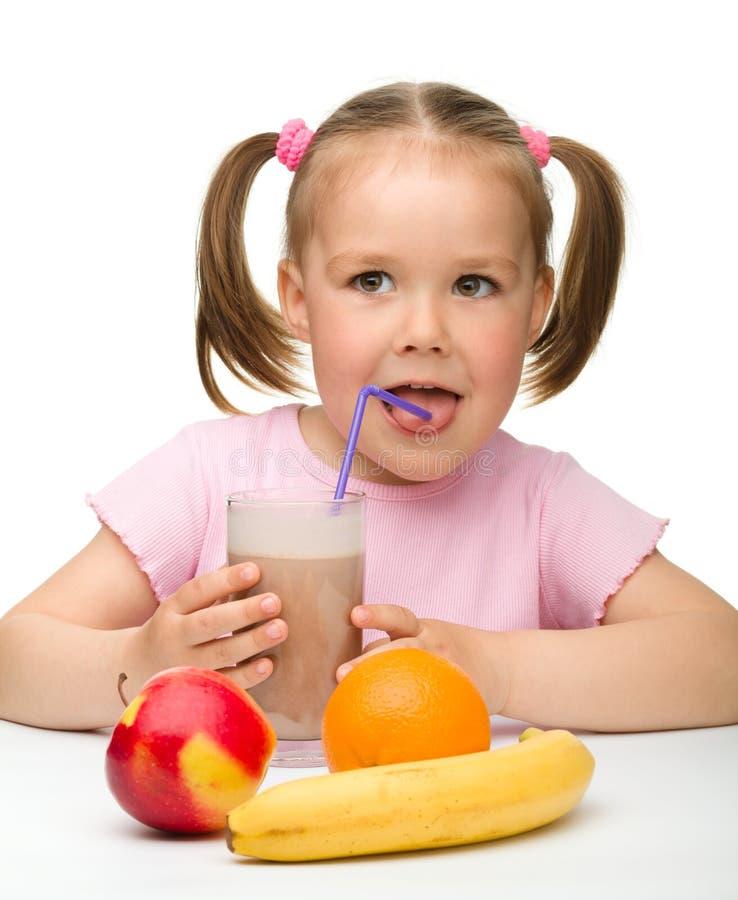 Little girl drinks fruit juice stock images