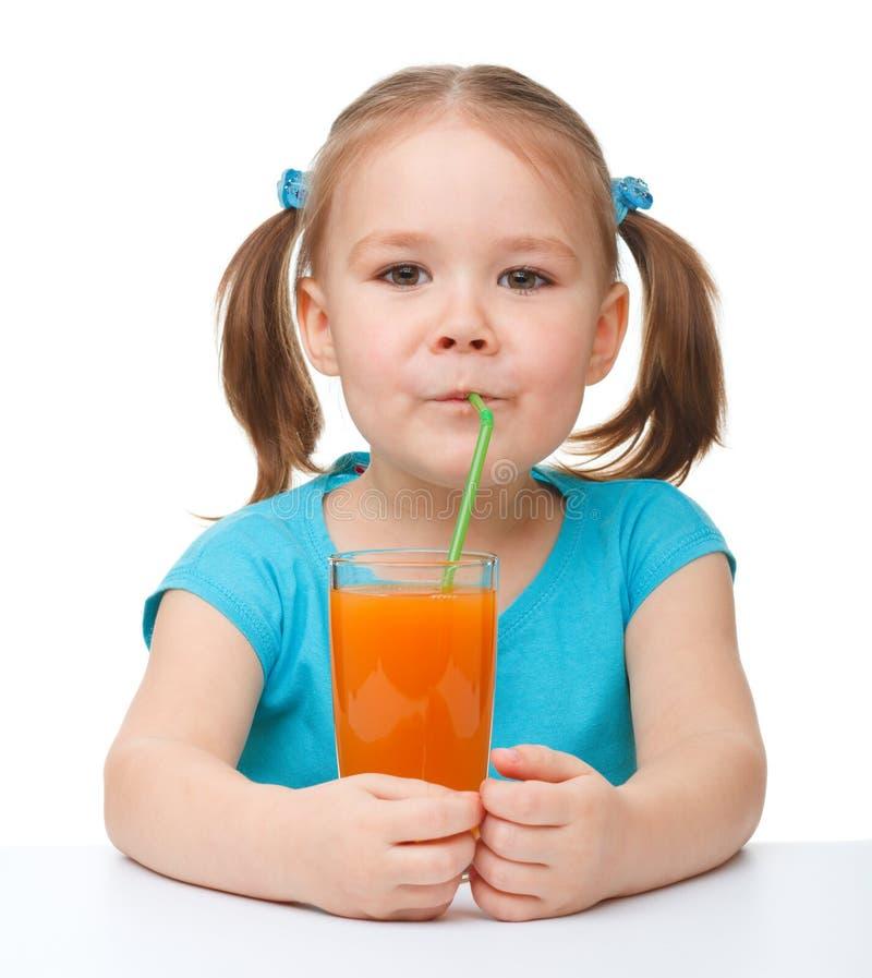 Download Little Girl Drinks Orange Juice Stock Photo - Image: 19018540