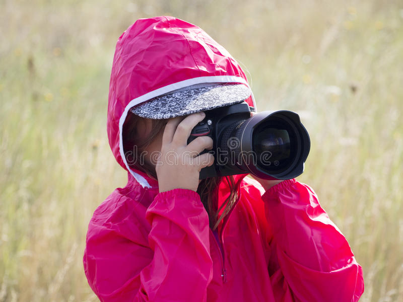 Little girl with DSLR stock image