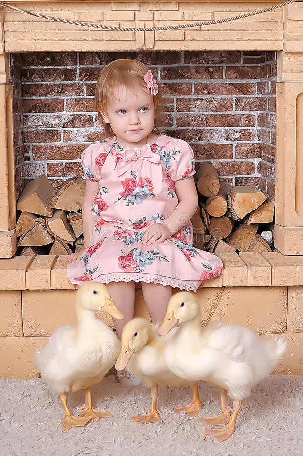 Little girl with ducklings royalty free stock photo