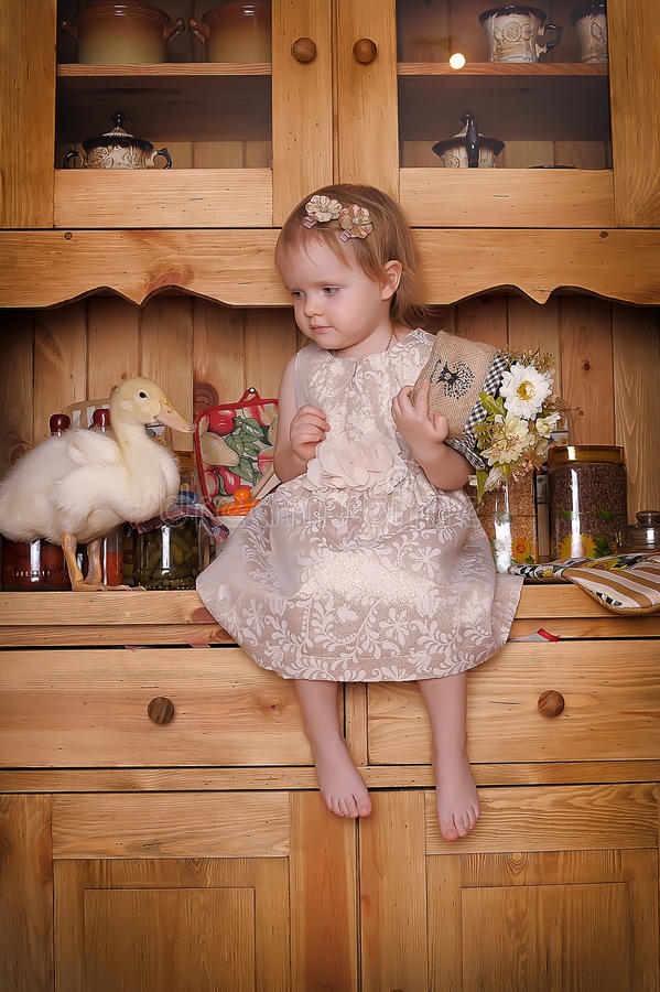 Little girl with ducklings stock photo