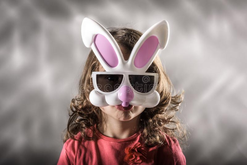 Easter bunny mask. Little girl with the Easter bunny mask royalty free stock photography