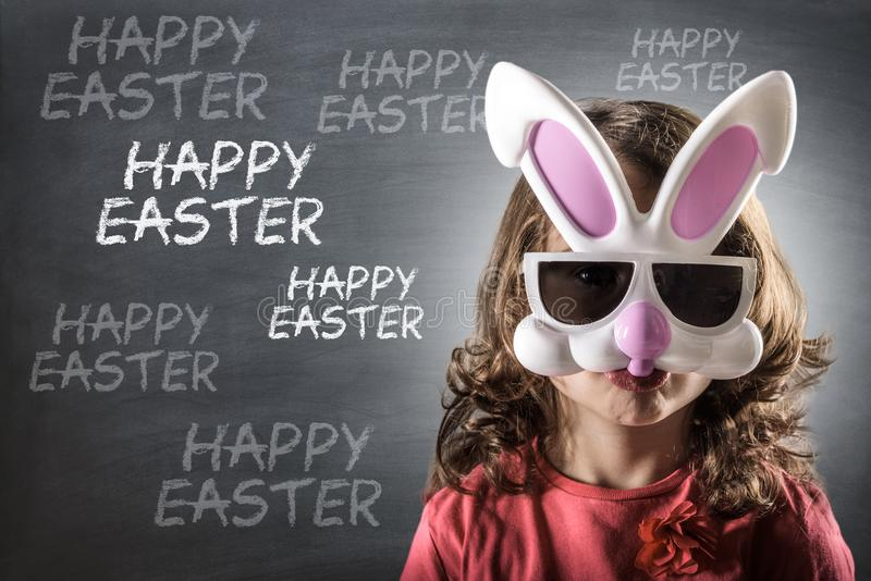 Little girl with the Easter bunny mask stock photos