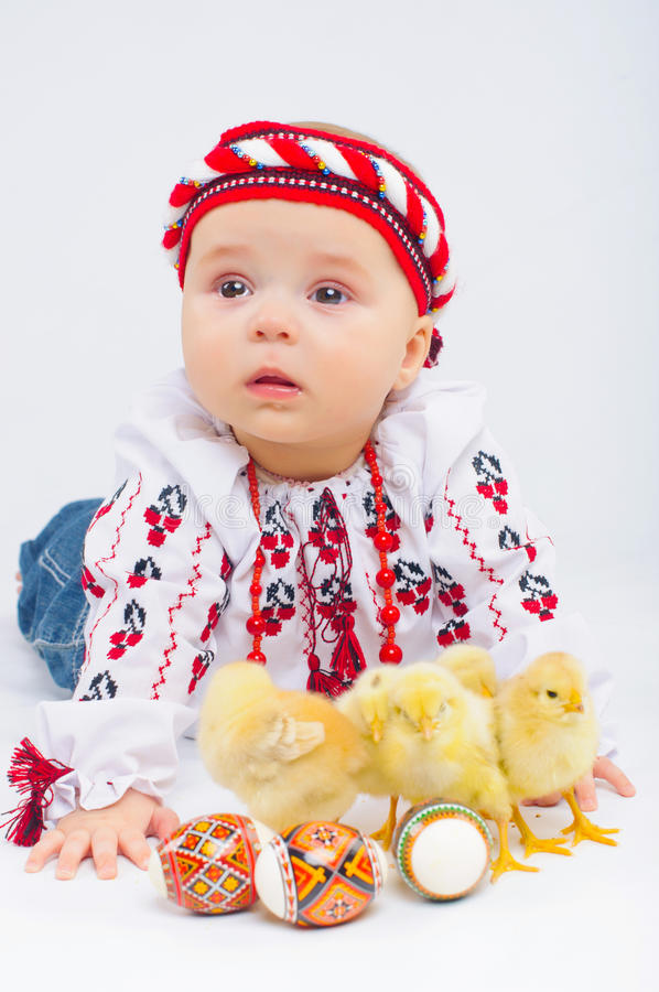 Little Girl With Easter Eggs And Baby Chickens stock photo