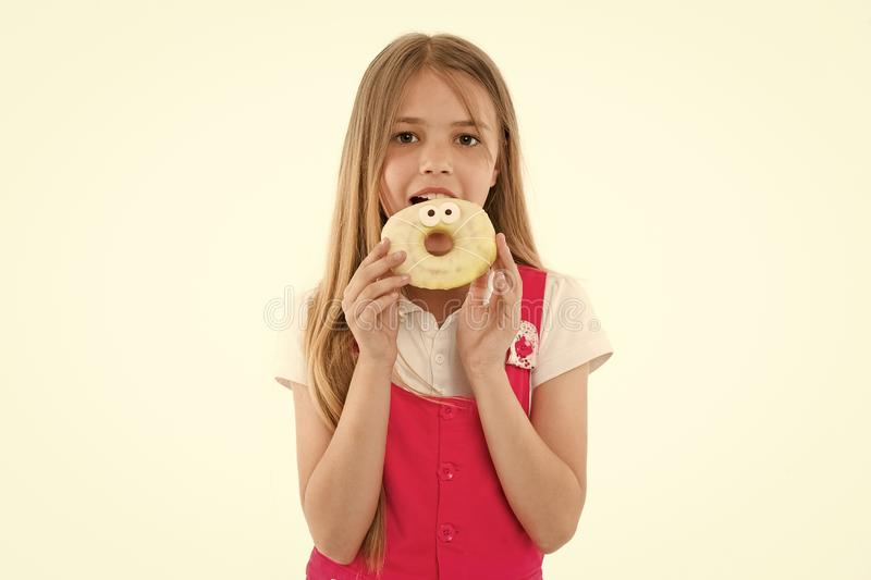 Little girl eat donut isolated on white. Child with glazed ring doughnut. Kid with junk food. Food for snack and dessert stock photography
