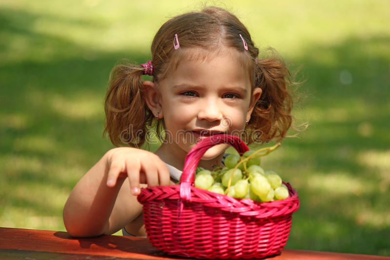 Download Little girl eat grape stock image. Image of delicious - 20685487