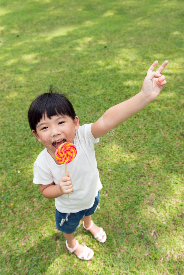 Download Kid with lollipop stock photo. Image of hand, asia, asian - 30290912