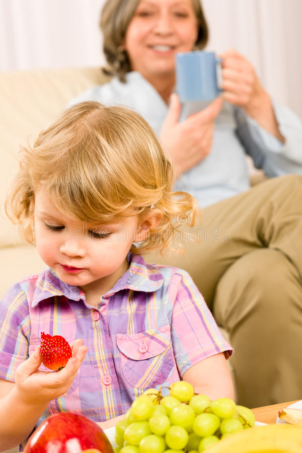 Download Little Girl Eat Strawberry Fruit With Grandmother Stock Photo - Image: 23024064