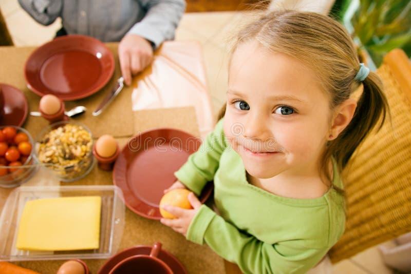 Little girl eating stock image