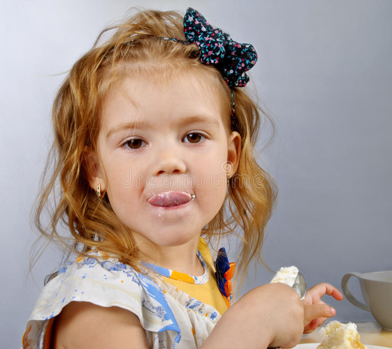 Little Girl Eating Stock Photos