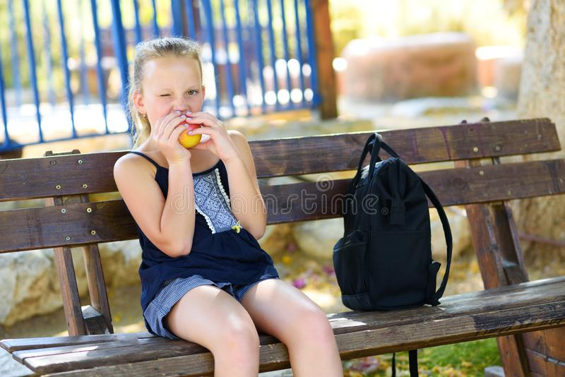 Little girl eating apple. Healthy nutrition. royalty free stock photo