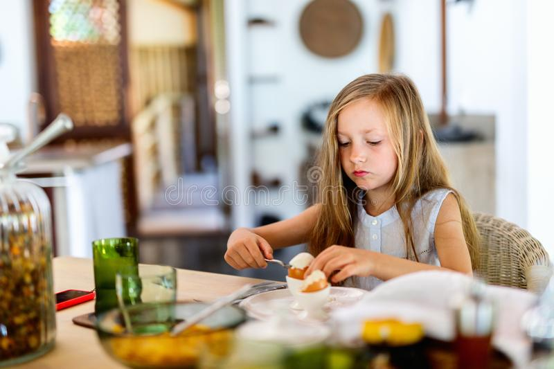 Little girl eating breakfast royalty free stock photography