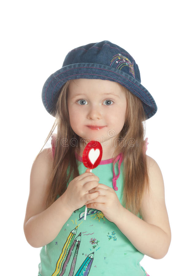 Download Little Girl Eating Candy  Lollipops Stock Photo - Image: 18786324