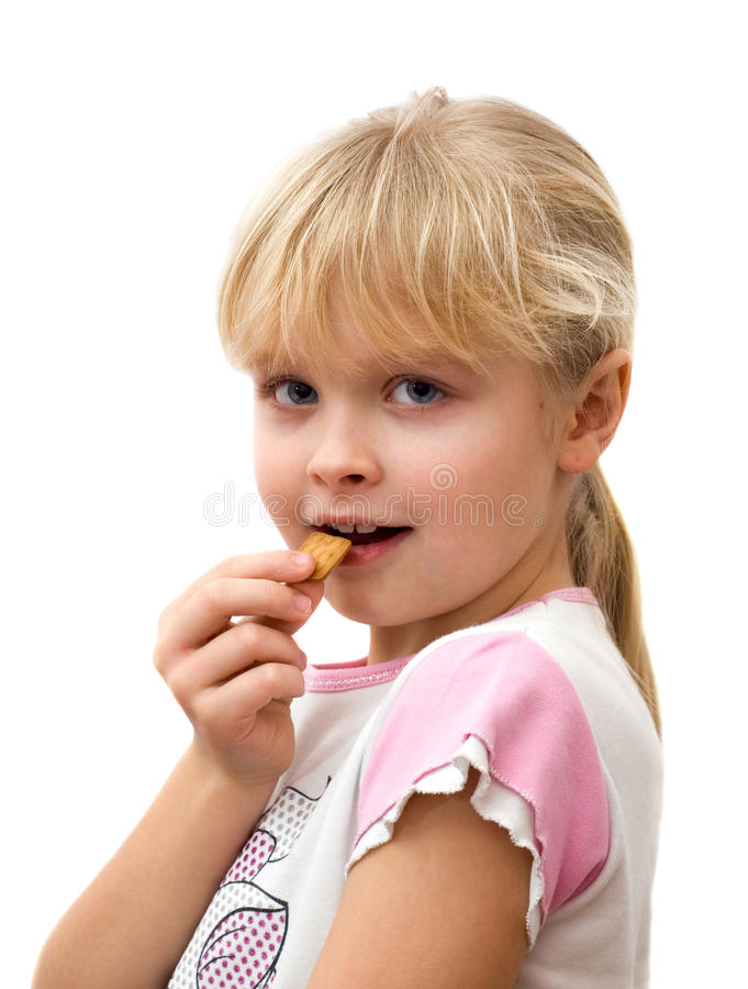 Free Little Girl Eating Cookies Stock Photography - 17492642
