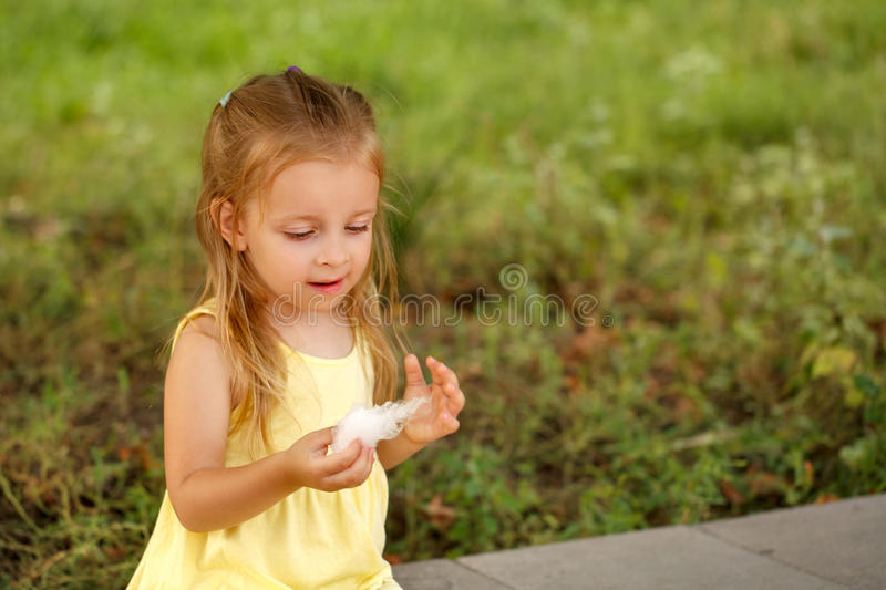 Little girl eating cotton candy. stock images