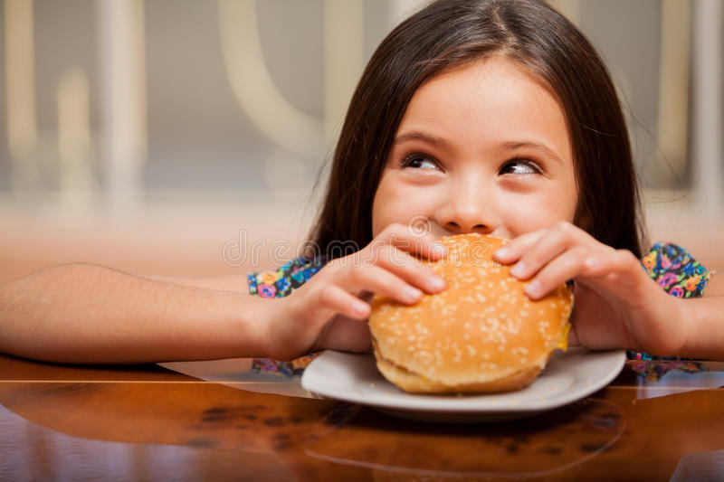 Download Little Girl Eating A Hamburger Stock Image - Image: 34084031