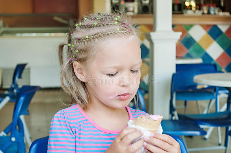 Download Little Girl Eating Ice Cream Stock Photo - Image: 37903570