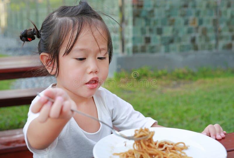 Little girl eating Japanese yakisoba noodles stock photos