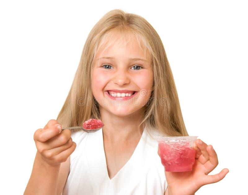Little girl eating jelly stock photo