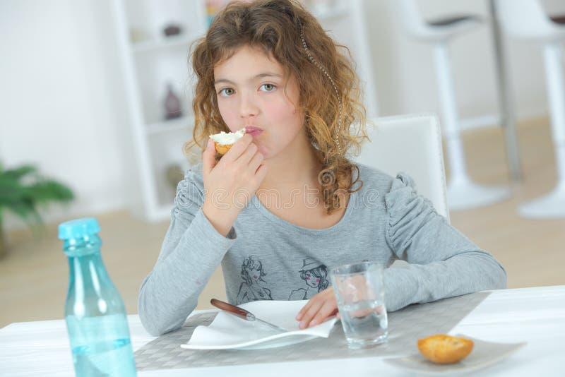 Little girl eating snack stock photo