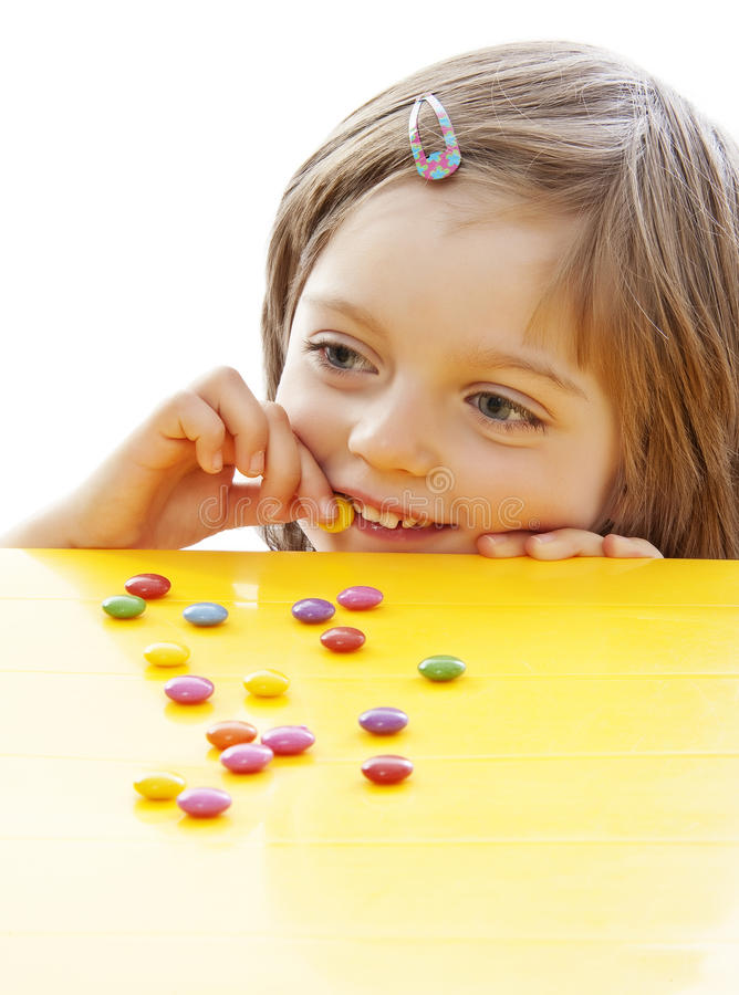 Little Girl Eating Sweets Royalty Free Stock Photography