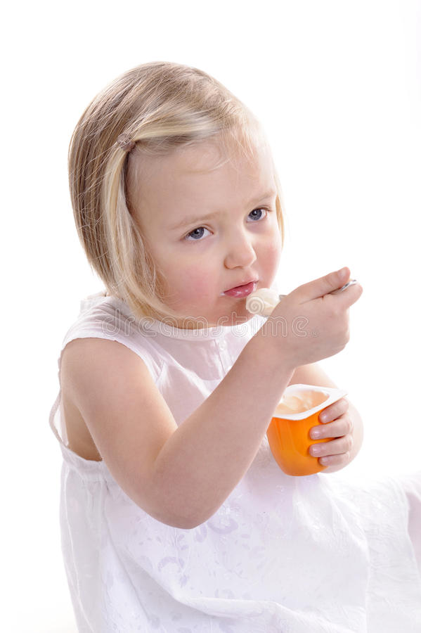 Little Girl Eating Yogurt Stock Images