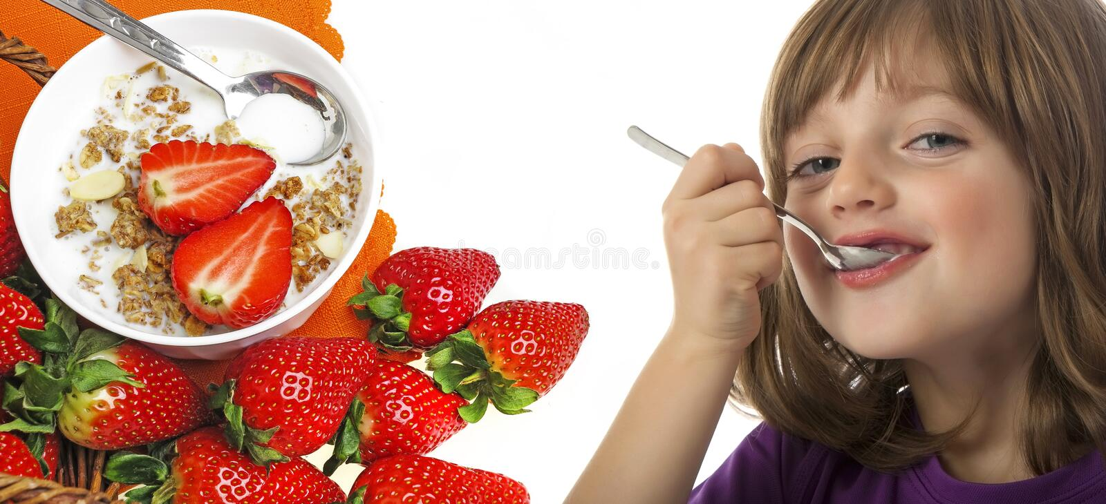Little girl eating. A yogurt close up royalty free stock images