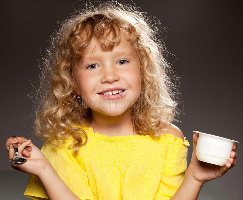 Download Little girl eating yogurt stock photo. Image of happiness - 40986930