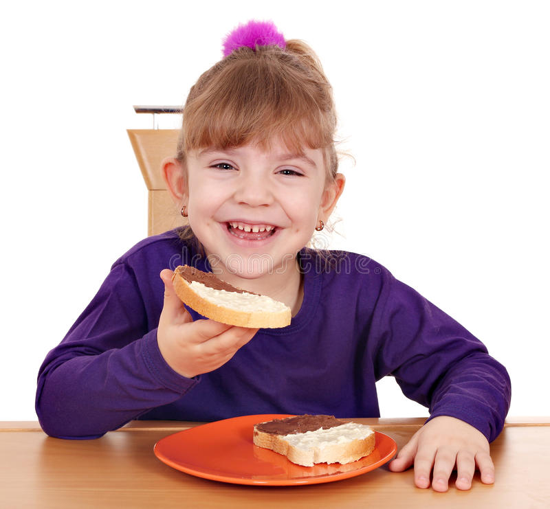 Download Little Girl Eats Bread With Chocolate Stock Image - Image: 23400391