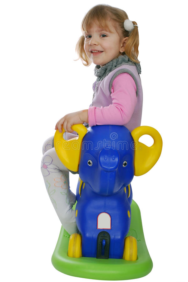 Little Girl With Elephant Toy Stock Images