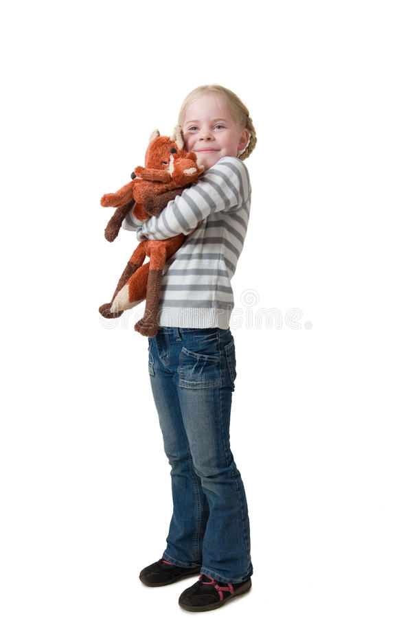 Little girl embraces soft toy stock images