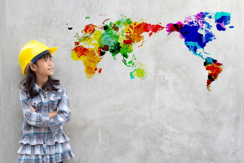 Little girl engineering with watercolor world map royalty free stock photos
