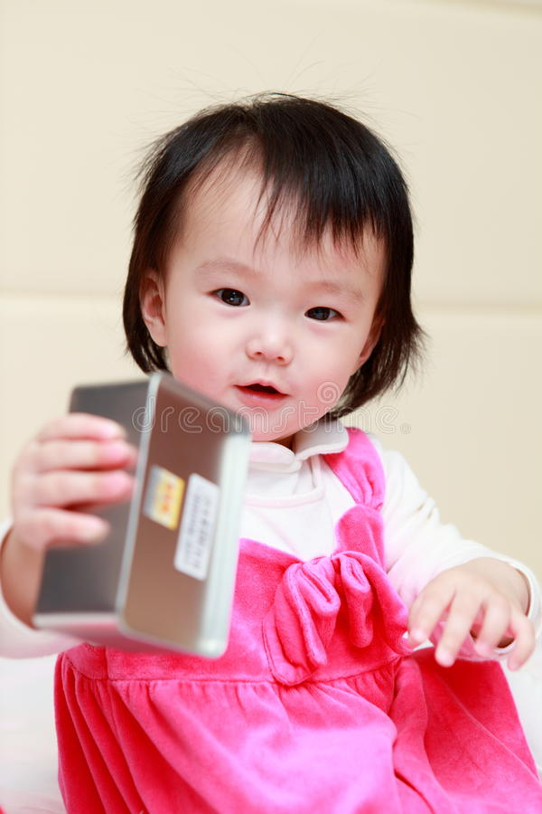 Download Little Girl Enjoy With Iron Cans Stock Image - Image: 23958033