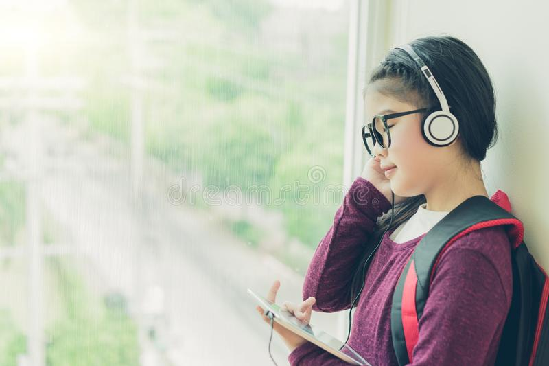 Little girl enjoy the music royalty free stock photo