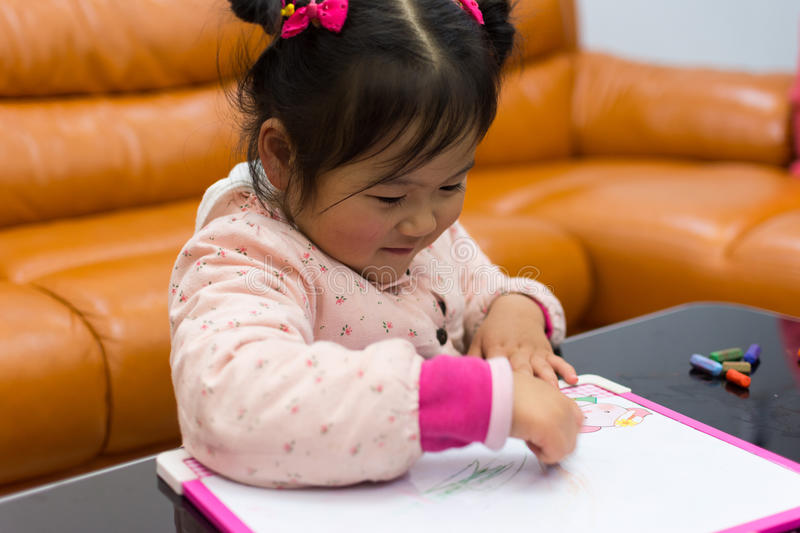 Little girl enjoying drawing pictures royalty free stock image