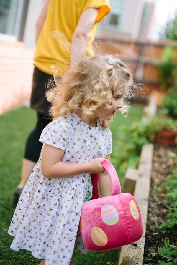 Little girl enjoying Easter Egg Hunt stock photos