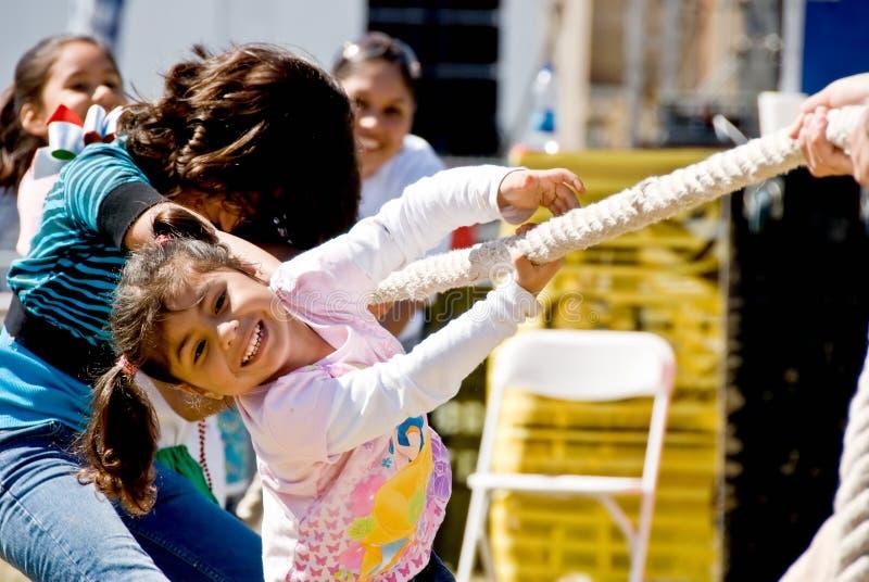 Little girl enjoying Tug of war royalty free stock photo