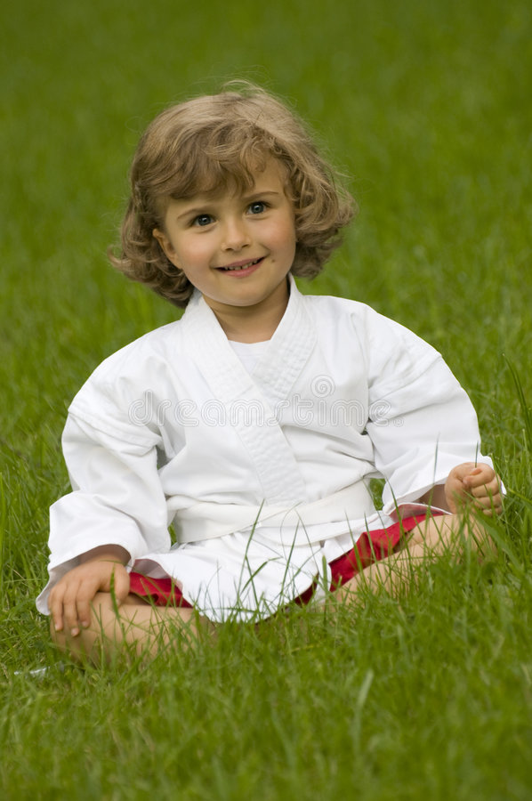 Little girl exercising in the garden stock photo