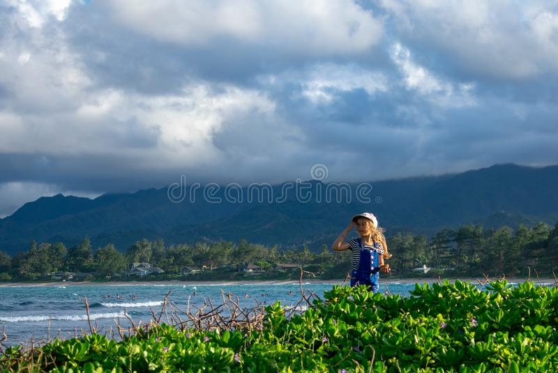 Little Girl Explores the Seaside stock image