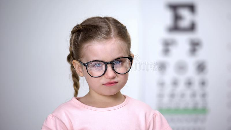 Little girl in eyeglasses crying feeling insecure, worrying about bullying. Stock photo royalty free stock photography