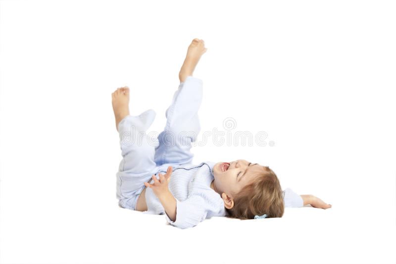 Little girl falling on her back stock images