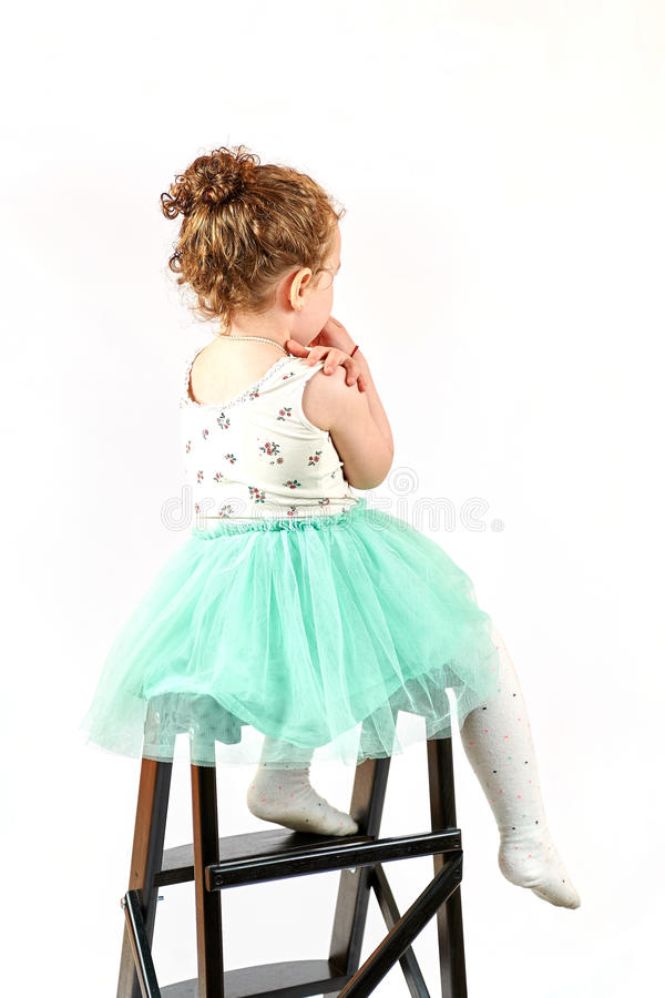 Little Girl Fashion Model in Green Dress. Fashion little girl in green dress, in catwalk model pose, stock photo. Image 11 royalty free stock images