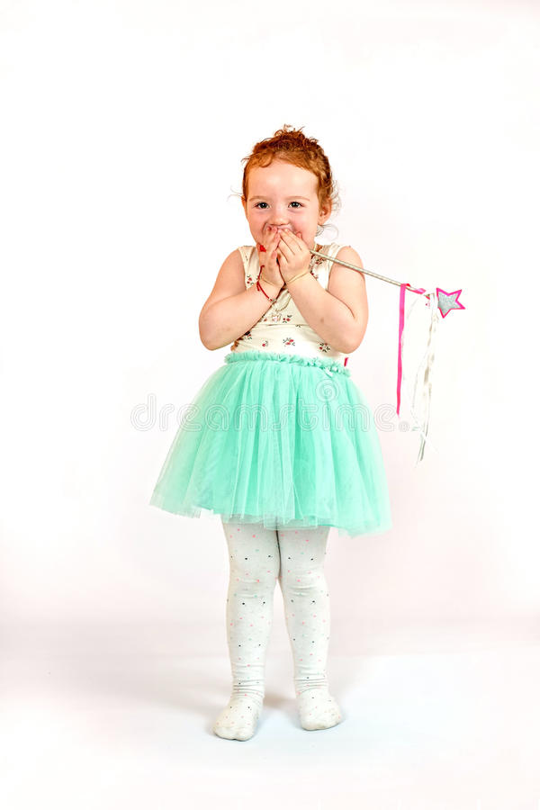 Little Girl Fashion Model in Green Dress. Fashion little girl in green dress, in catwalk model pose, stock photo. Image 03 royalty free stock images