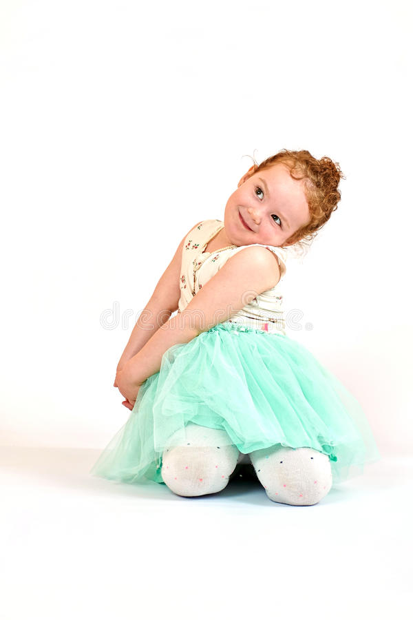 Little Girl Fashion Model in Green Dress. Fashion little girl in green dress, in catwalk model pose, stock photo. Image 07 royalty free stock images