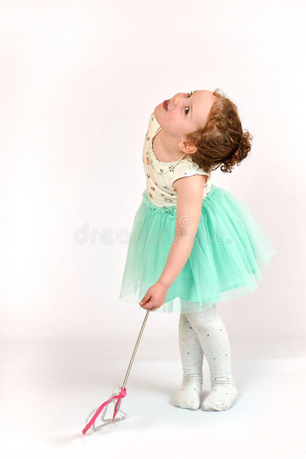 Little Girl Fashion Model in Green Dress. Fashion little girl in green dress, in catwalk model pose, stock photo. Image 04 royalty free stock photo